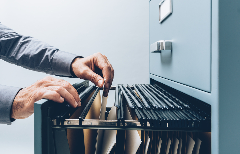 office clerk learning how to store and organize paper files